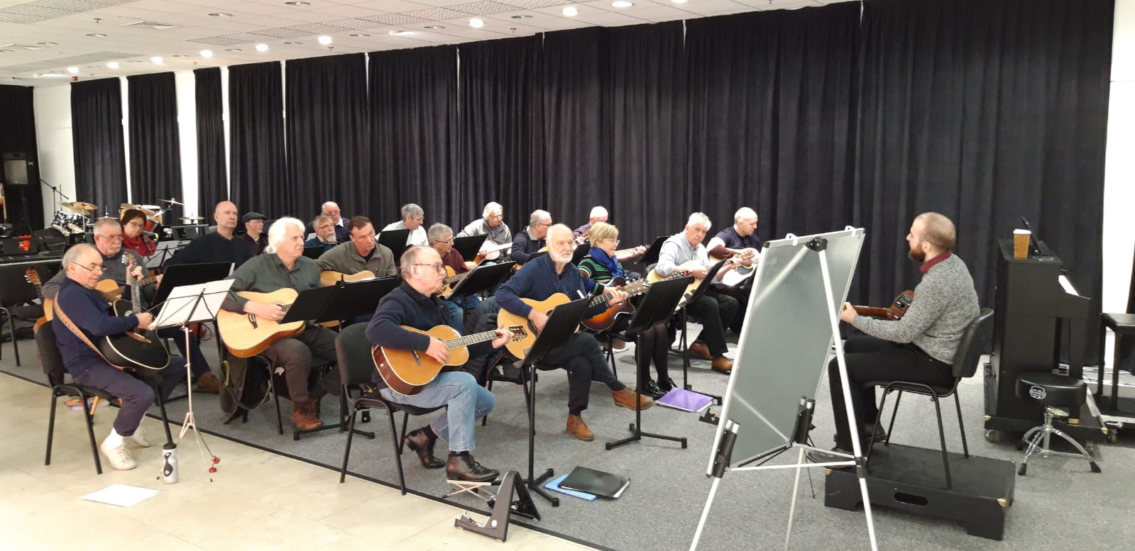 Bolton Music Service tutor Paddy leads a Guitar session in our Studio.